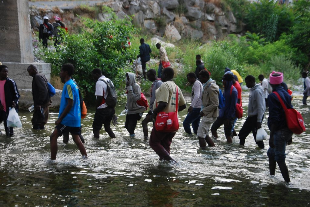 Migrants walking along the Roja river near Ventimiglia in north-west Italy towards the French border  Photo ANSACHIARA CARENINI