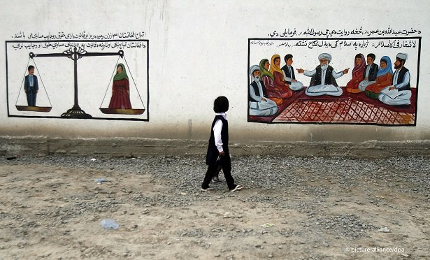 Women and men are equal under the law, and there is no forced marriage in Afghanistan, according to the posters Photo: picture alliance/Allauddin Khan