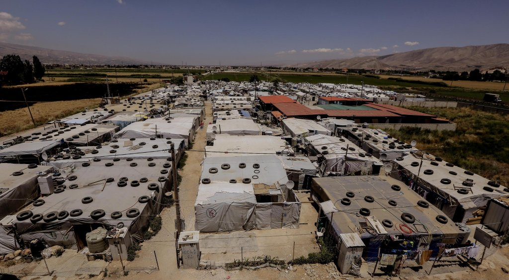 A view of the makeshift shelters at Al-Basma refugee camp in the Deir Zanoun area in the Bekaa Valley, Lebanon. Credit: EPA/NABIL MOUNZER