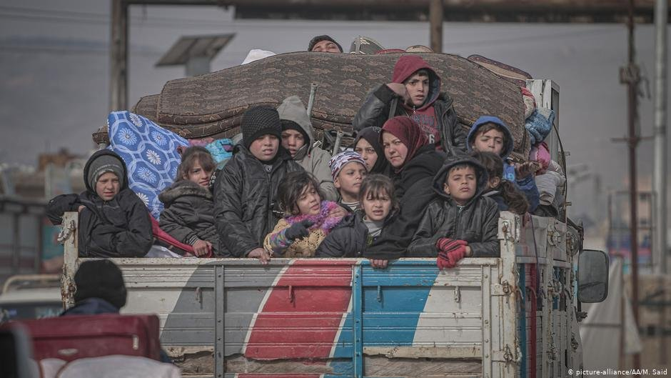 Syrian families are seen on a truck with their belongings on their way to safer zones in Idlib Syria on February 11 2020  Photo Picture-allianceAAMSaid
