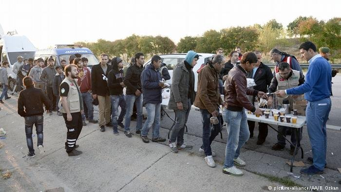 Refugees queue for food in Turkey