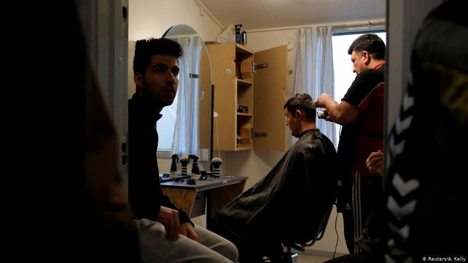 Residents at Kaershovedgaard a former prison and now a departure centre for rejected asylum seekers line up to have a free haircut  Photo ReutersAKelly