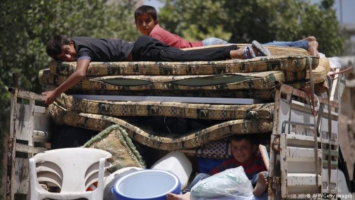 عکس از دویچه وله/ بیجاشدگان داخلی سوریه به مناطق اصلی خود باز میگردند.