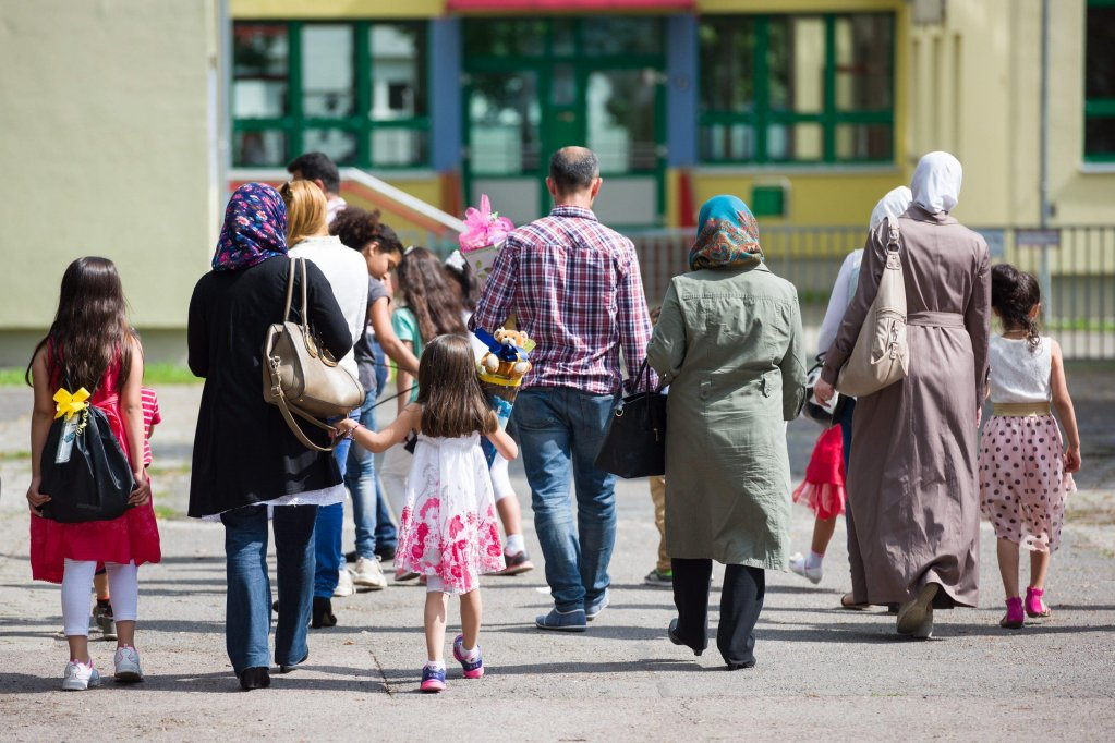 Migrants from Syria taking their children to the school enrollment ceremony at the elementary school 'Kastanienallee' in Halle, Germany | Credit: ARCHIVE/EPA/STRINGER