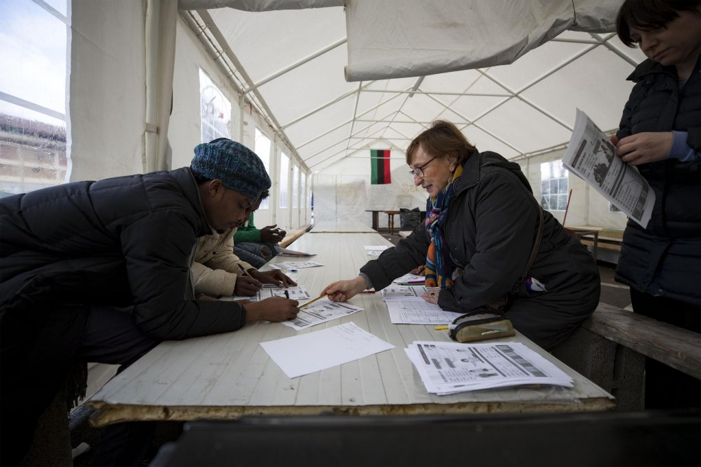 "Migrants during an Italian-language lesson inside a tent managed by some volunteers at the so-called ""Baobab Camp"" near the Tiburtina station in Rome, February 19, 2018. ANSA/MASSIMO PERCOSSI"