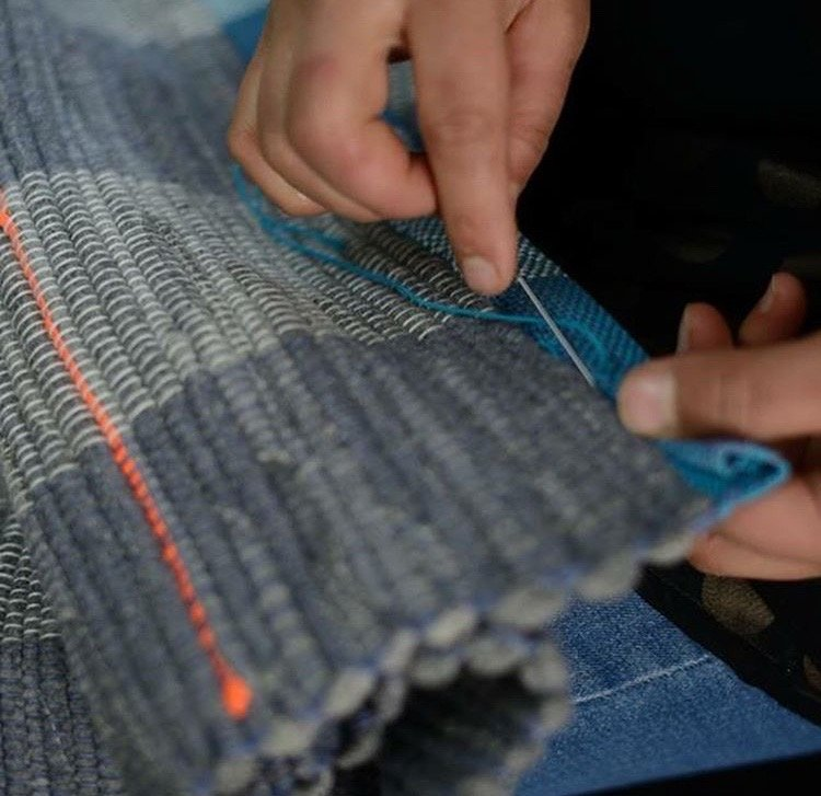 Finishing off one of Love Welcomes products in the workshop in Athens  Photo Courtesy of Abi Hewitt Love Welcomes