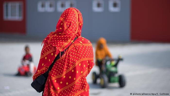 Woman standing at asylum center in Tübingen, Germany