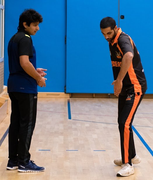 Bryan R., co-founder of the club (right), demonstrates a technique for a young team member. Bryan likes to speak with his team in German so they can better understand the language   Photo: Kai Dambach