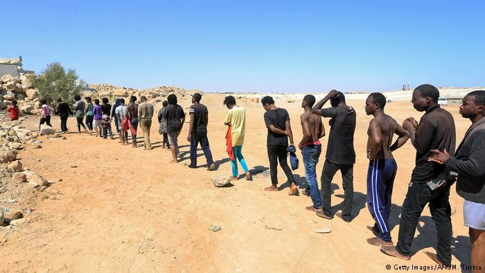 Migrants in Libya desert