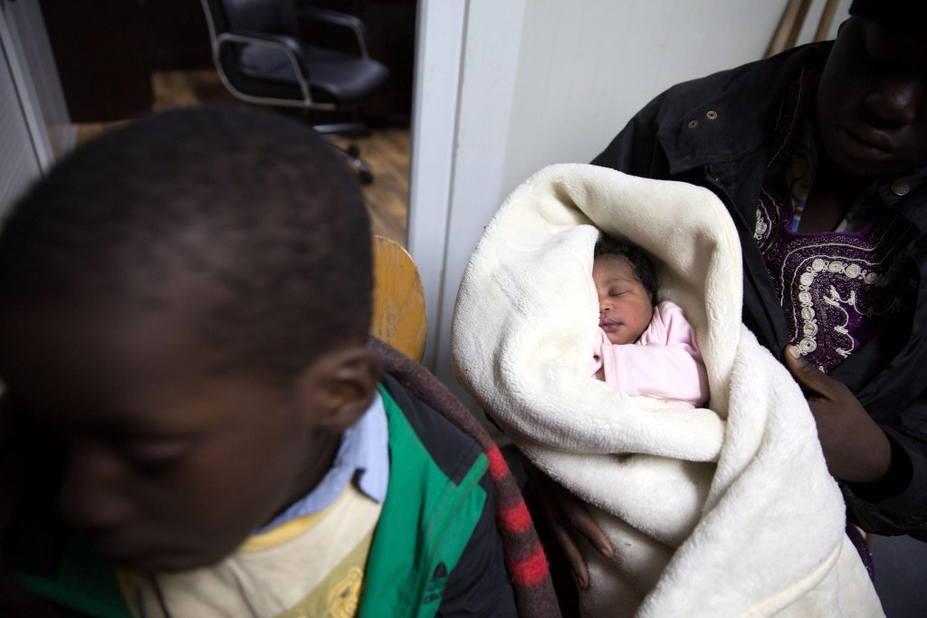 A 20-days-old newborn sleeps at Tripoli port, Libya, after an inflatable boat was found off the coast of Tripoli by the Libyan Coast Guard carrying some 120 migrants, including four children, 10 women, and the newborn. Credit: EPA/STR
