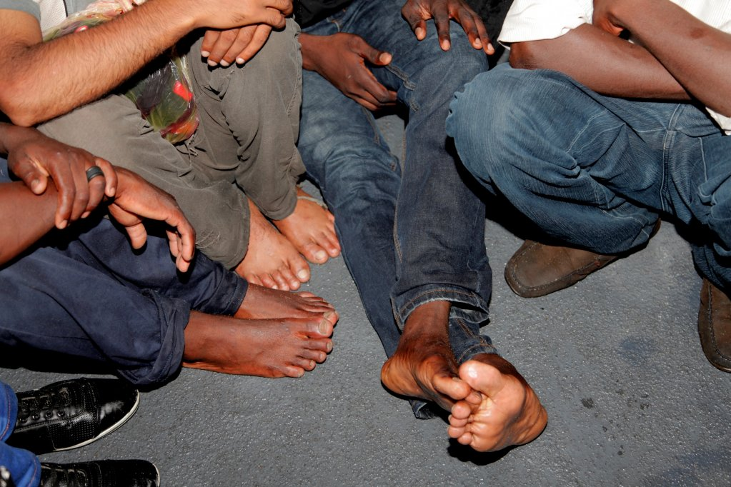 A picture of the feet of young people who are highly at risk of trafficking on the long road to Europe  Photo IOM