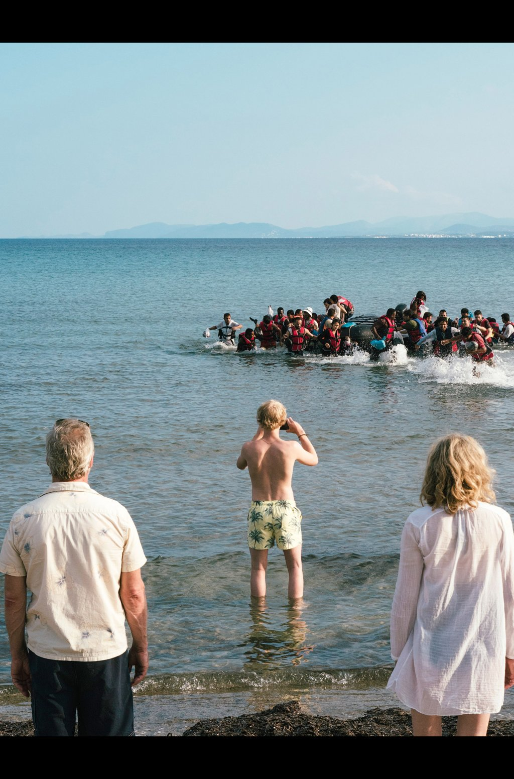 The Hennings family stop and watch as migrants literally arrive on their holiday beach  Credit Screenshot from Arte production Eden  SWRPierre Meursaut