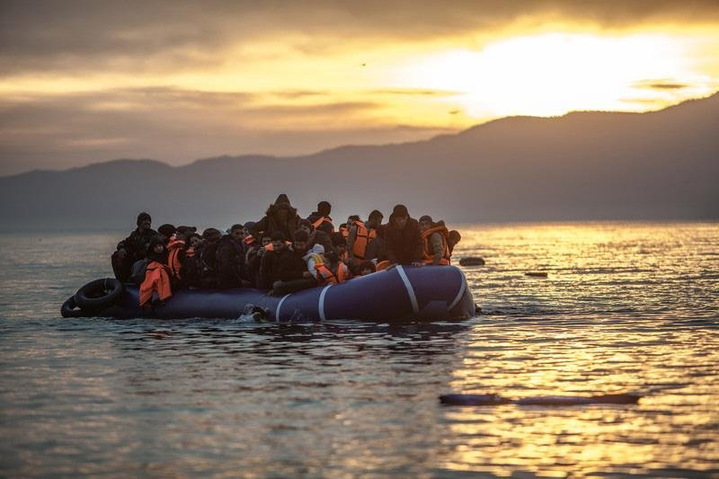 The picture shows a dinghy crowded by migrants arriving in Lesbos, Greece. Credit: ANSA/Oxfam