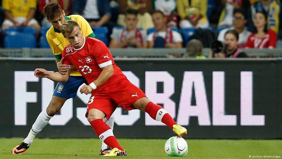 Xherdan Shaqiri (red) battles Brazil's Neymar for the ball