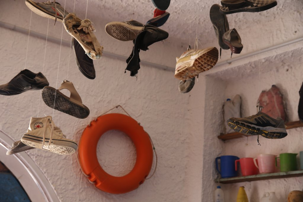 Shoes dangling from the ceiling, a life preserver in the background - a peak inside the Porto M museum | Photo: Ignacio Pereyra