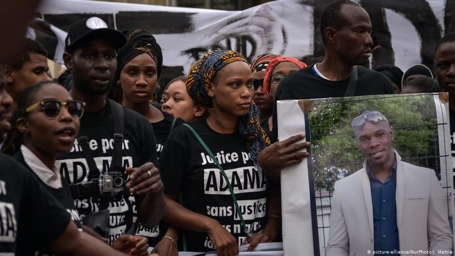 Protesters have been calling for the 'truth' surrounding the death of Adama Traoré (pictured in placard) | Photo: picture-alliance/NurPhoto/J. Mattia