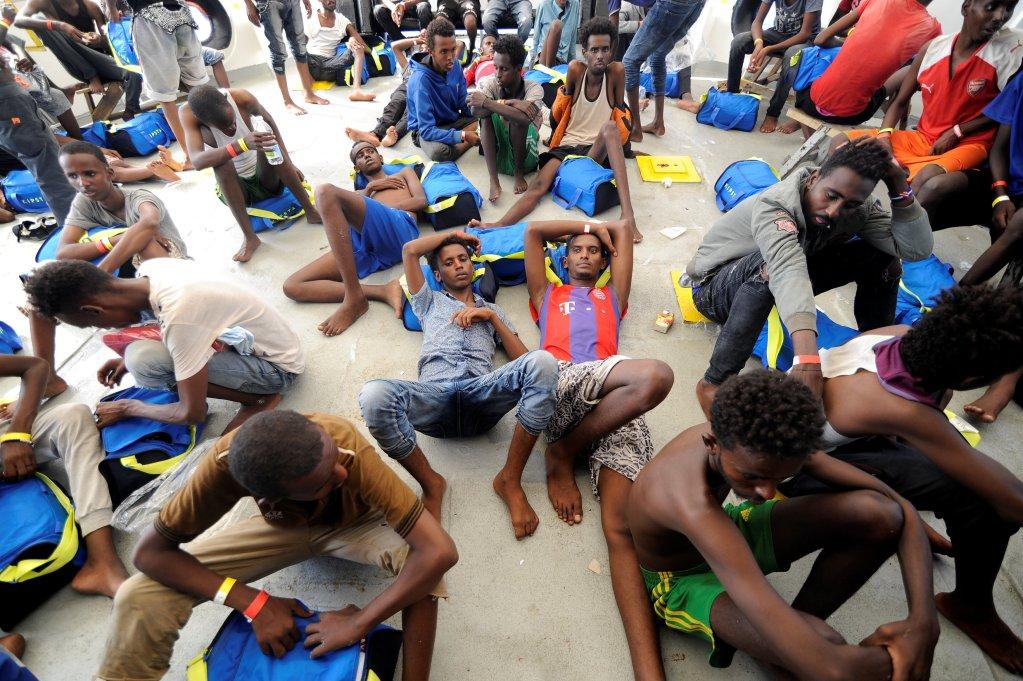 REUTERS/Guglielmo Mangiapane |Des migrants secourus le 10 août 2018 par le navire humanitaire «Aquarius», affrété par les ONG SOS Méditerranée et Médecins sans Frontières (MSF).