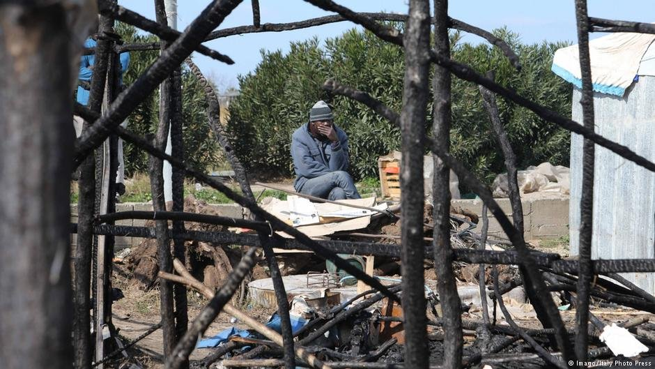 A man looks on after a fire at the San Ferdinando migrant shanty town | Credit: Imago, Italy Photo Press, Albano Angilletta