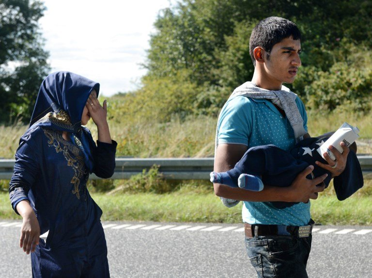 From file: A young refugee family walking along highway E45 from Padborg in Denmark near the border with Germany in 2015   Photo: ©SCANPIX DENMARK/AFP