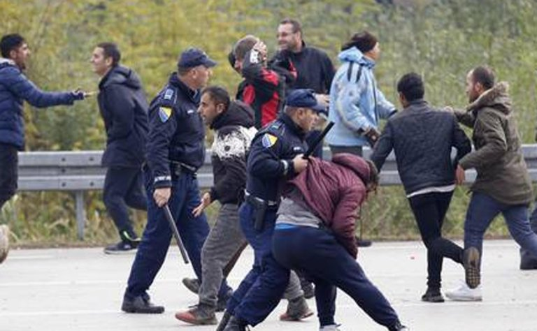 migrants clashing with Bosnian police in Maljevac, Bosnia. PHOTO/ANSA/AP Photo/Amel Emric