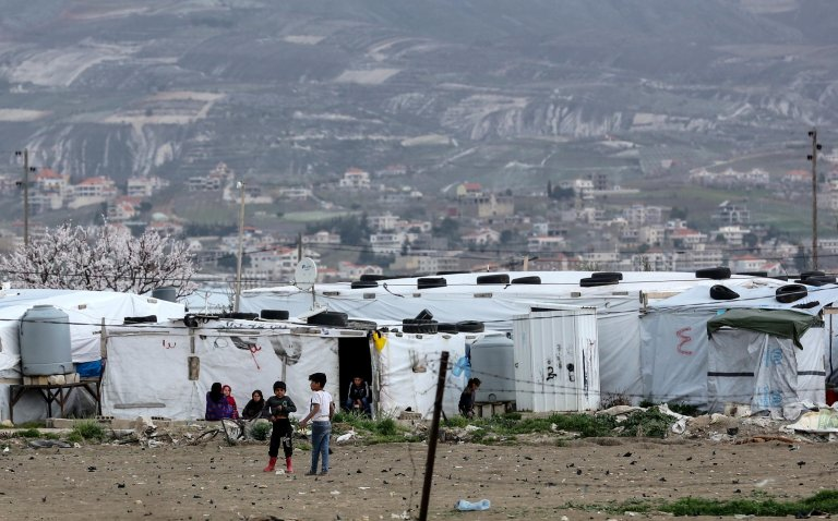 Syrian refugees in front of makeshift tents at Al Faydah refugee camps, near Zahleh in the Bekaa Valley, Lebanon, 12 March 2020 | Photo: EPA/NABIL MOUNZER