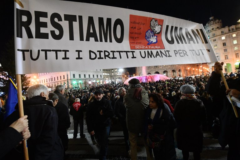 A demonstration against the security and migration decree in Genoa   Photo: ANSA/LUCA ZENNARO