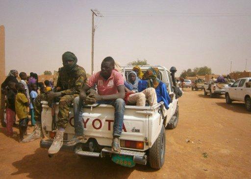 AFP/STR |Des migrants qui se trouvaient dans le désert secourus par les autorités nigériennes et ramenés à Arlit (photo d'illustration / archives).