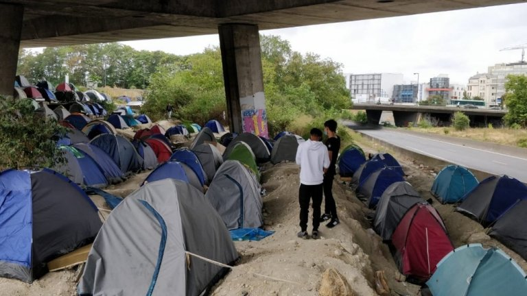 Around 300 people live under the A1 national highway in the Parisian suburb of Saint-Denis camp. Credit: InfoMigrants