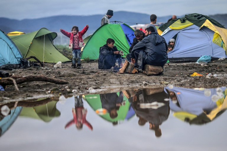 Refugees sit between tents at the border between Greece and the Former Yugoslav Republic of Macedonia (FYROM), near Idomeni, northern Greece   Credit: ANSA archive