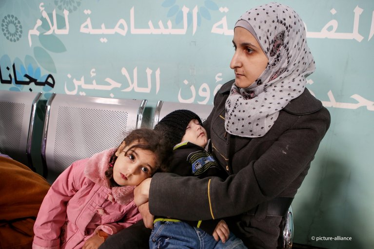 Syrian refugees wait at the registration office of the UNHCR in Amman, Jordan | AP Photo/Raad Adayleh