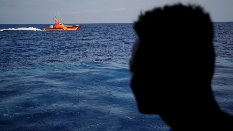 Juan Medina, Reuters | A migrant looks at rescue boat in central Mediterranean Sea, August 8, 2018.