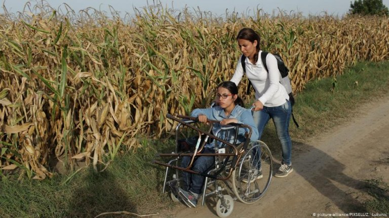 Nujeen Mustafa being pushed by her sibling in Croatia. | Credit: picture-alliance/PIXSELL/Z. Lukunic