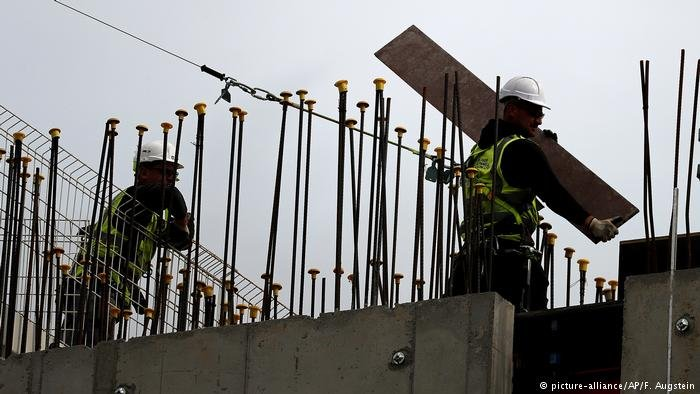 Construction workers in Britain | Photo: Picture-alliance/AP/F.Augstein