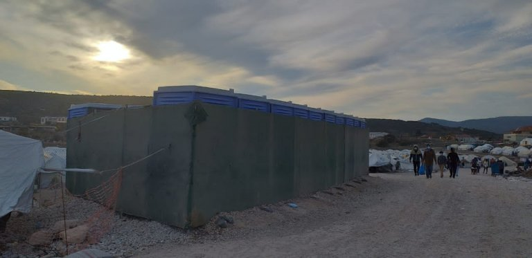 Shower cabins for women installed in the Lesbos RIC a month ago are without hot water, a resident told InfoMigrants | Photo: Private