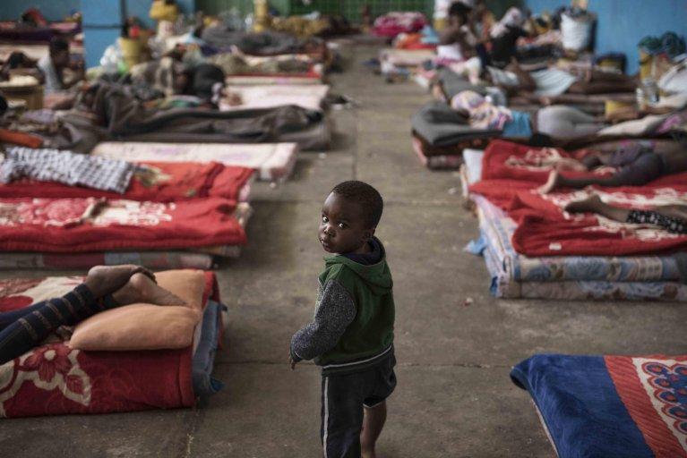 The photo shows a child at a hosting center in Zawiya, Libya. Credit: UNICEF/Romenzi