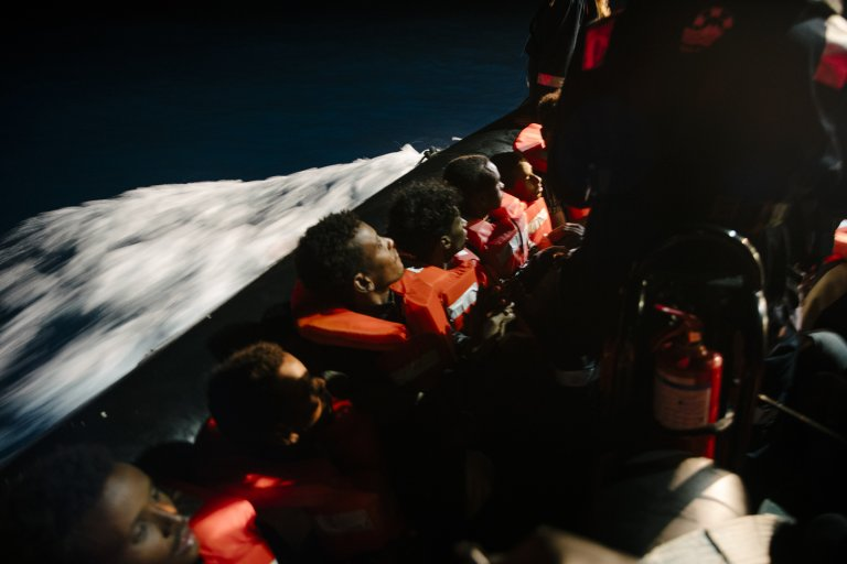 Rescue crew of Sea-Watch 4 hands out life jackets to about 97 people in distress in the central Mediterranean | Copyright: Fabian Melber/Sea-Watch.org