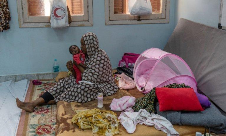ANSA /  مهاجرة سودانية التي وصلت إلى ليبيا في 2013 وهي تقيم بإحدى المدارس المصدر: أنسا/ زهير أبو سرويل.