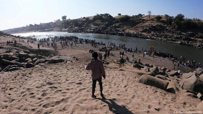 Ethiopians who fled Tigray at the Setit River on the Sudan-Ethiopian border   Photo: El Tayeb Siddig/REUTERS