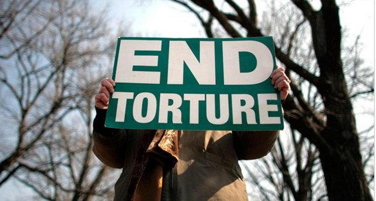 Protesters at a rally against torture | Source: UN Committee Against Torture