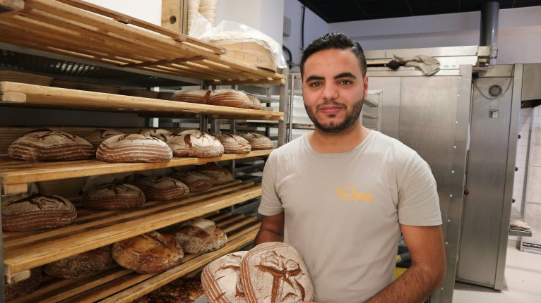 Mohamad enjoys earning his bread and butter at a bakery | Credit: Sertan Sanderson