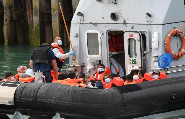 A Border Force vessel brings in migrants found off the coast of Dover, Kent, Britain, 19 August 2020. | Photo: EPA/ANDY RAIN