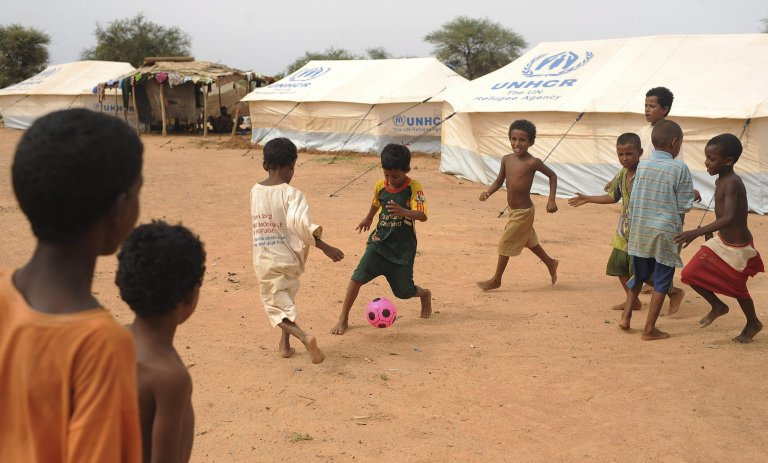 Kids from Mali playing soccer at a refugee camp near Dori, Burkina Faso, July 4, 2012. EPA/H. Fohringer
