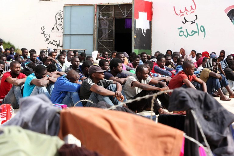 Detained migrants sitting in the Abu Salim detention center in Gasr Garabulli, 60 kilometers east of Tripoli, Libya | Photo: EPA/STR