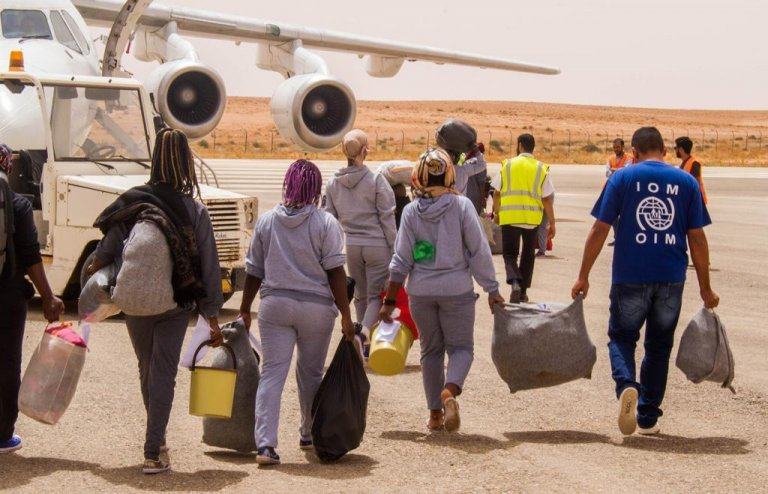 Migrants boarding a charter flight at Tripoli's Mitiga Airport | Photo: IOM/Hmouzi