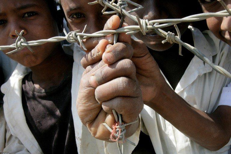 AFP PHOTO/ASHRAF SHAZLY |Des réfugiés érythréens dans un camp de migrants au Soudan (photo d'illustration).