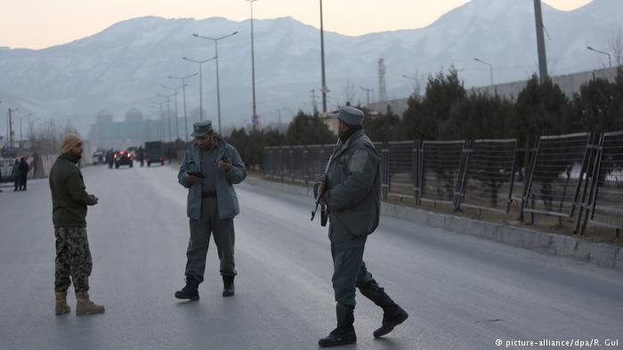 Afghan security forces stand guard near site of two blasts in Kabul