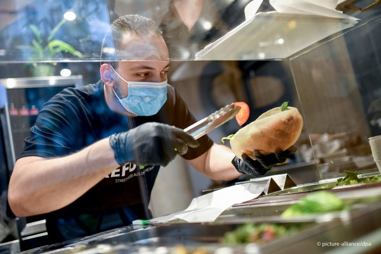 "Syrian refugee Salah Dahhan prepares Arab food at Berlin eatery ""Refueat"" 