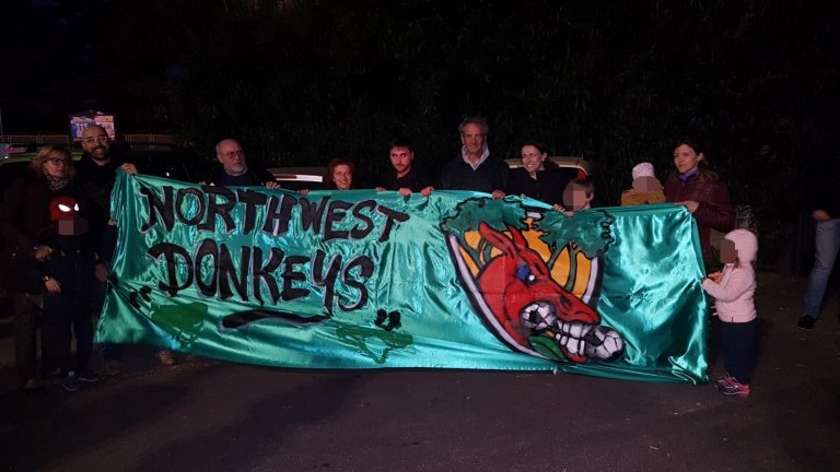 The sit-in organized by Roman multi-ethnic team 'Pineto United' to protest against the definitive shutdown of a migrant hosting center where some of the players live | Credit: ANSA