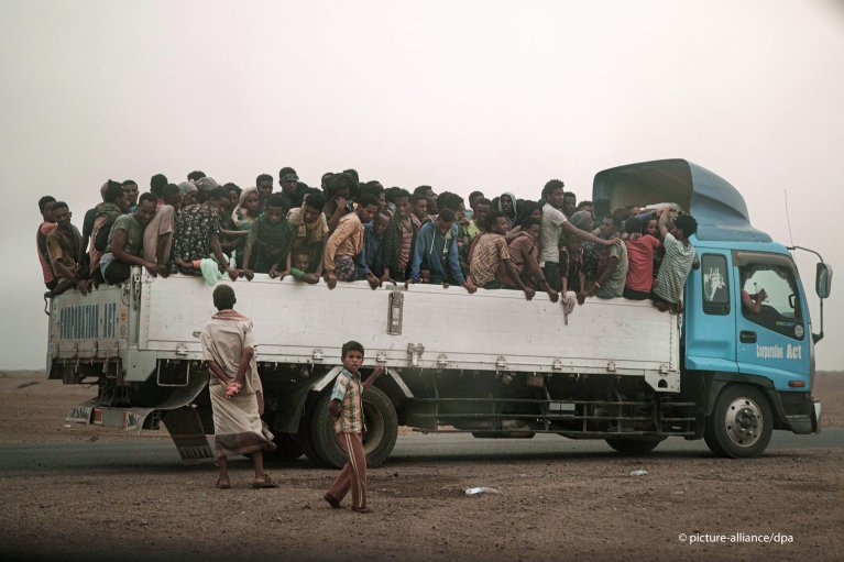 "Smugglers move migrants on a  truck to a ""hosh"" lock up in southwestern Yemen 