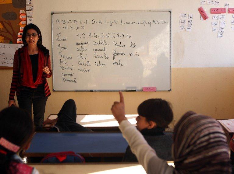 PATRICK BAZ / AFP |De jeunes réfugiés irakiens et syriens lors d'un cours de français au Liban, le 25 novembre 2016 (image d'illustration).